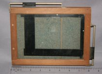 Image of A wooden frame for printing negatives of various sizes.