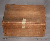 """Image of Wooden Box with no lock, masking tape """"lock"""". Contents are cataloged separately (2006.03.77)"""