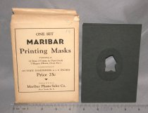 Image of Set - Maribar printing masks in envelope. Stored in 2006.03.49 Wooden box.