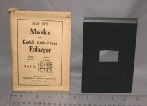 Image of One set metal masks for Auto-Fucus Enlarger with envelope. Seven (7) masks same as 2006.03.82.