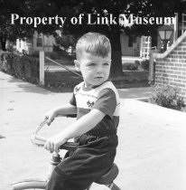 Image of Young Boy On Tricycle - Black and white negative of NW 505. Same as NW 504. Young boy on tricycle.