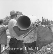 Image of Three Men Laying Pipe