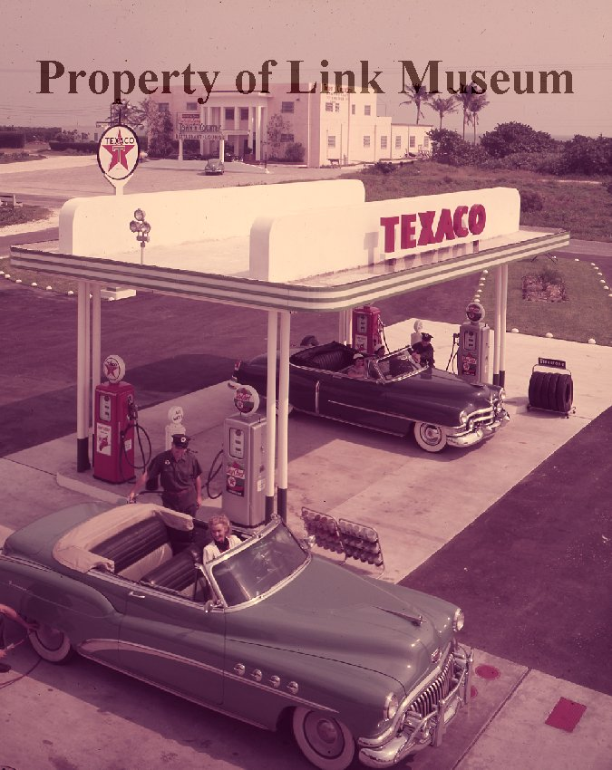 TEXACO Service Station - Two women sit in their cars at a Miami