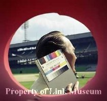 Image of man At Stadium - Man at stadium, holding gray card with color bars.  (Client:  Popular Science Magazine)