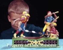 Image of Baseball players coin bank with boy.