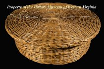 Image of Large, shallow wicker sewing basket with flat round lid. **At one time contained needles, thread, tatting, shuttles, darning eggs, etc.