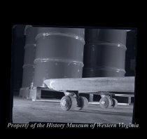 Image of 2 Barrels on cart with 6 wheels