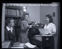 Image of 3 ladies in office with files