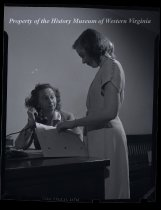 Image of 2 women in office, one on phone