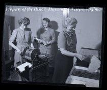 Image of 3 ladies at copy machine