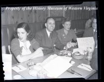 Image of 2 ladies, 2 men at dining table