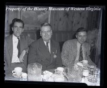 Image of 3 men at dining table