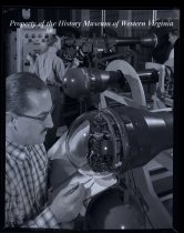 Image of 2 men working with machines