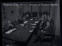 Image of Board of Directors seated at table