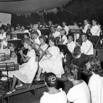 Image of UNRA-P1497-1 - Photograph of the Art and Music Camp, Lake Tahoe: three unidentified women watching an orchestra of boys and girls play. (1970)