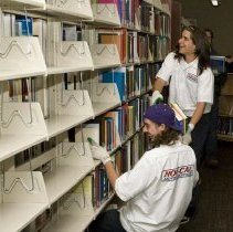 Image of UNRA-P3523-20 - Three Nor-Cal Moving Services staff shelving books (July 7, 2008)