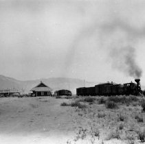 Image of UNRS-P1964-2 - Photograph of Virginia and Truckee Railroad; train pulling away from station.