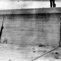 Image of UNRS-P2008-18-2713 - [Newland's Project- CCC BR-35]. [View showing open joint and crack in outside wall of right spillway, Lahontan Dam, which have been partially filled with composition of latex and oil. Milton Murphy. March 4, 1938].
