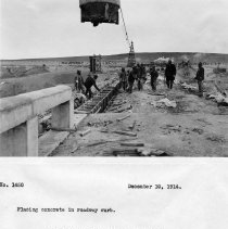 Image of UNRS-P2008-18-3829 - Placing concrete in roadway curb. Camera on right spillway looking north. December 10, 1914.