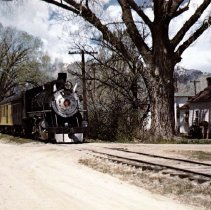 Image of UNRS-P2577-D - Photograph of easing towards the Carson City Passenger Depot is Virginia & Truckee Railway Second No. 5 in her final week of operation over the famous Nevada Short line. Photo by Al Rose. Published and copyrighted 1975 by Lyman E. Cox.