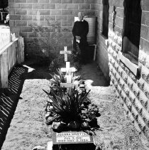 Image of UNRS-P1988-60-128 - Photograph of Gareth Hughes (Brother David) in corner of graveyard next to St. Mary's Episcopal Church in Nixon, Nevada that includes the graves of little white children who died on the reservation; children of white teachers and missionaries.