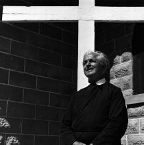 Image of UNRS-P1988-60-135 - Photograph of Gareth Hughes (Brother David) in front of St. Mary's Episcopal Church in Nixon, Nevada