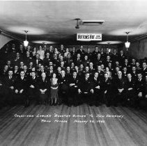 "Image of UNRS-P1989-53-4 - Organized labor's ""Booster Dinner"" to Jack Dempsey. Reno, Nevada. January 22, 1932. Jack Dempsey, center front; second to his right, William Woodburn, Sr. (#10); next right, James McKay (#11). Pete Petersen, standing rear (#69). The occasion was an attempt to convince Dempsey to move his operations to Reno."