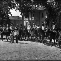 Image of UNRS-P1989-55-2760 - Photograph of Indians on horses for parade in front of Courthouse.