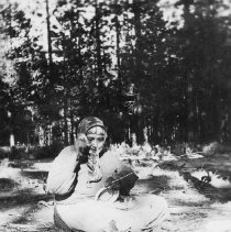 Image of UNRS-P1991-24-01 - Photograph of women weaving basket. Handwritten on verso: Susie Rube making basket.  Near Bijou, California, where she and husband Charlie spent summer, like older Washo, who followed traditional summer move from Carson Valley to Lake Tahoe.