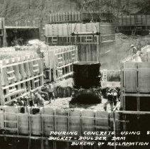 Image of UNRS-P1995-38-05 - Pouring concrete using 8 cu. yd. Bucket- Boulder Dam.  Bureau of Reclamation photo by Frasher's Fotos, Pomona Calif.