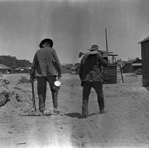 Image of UNRS-P1989-55-2993 - Photograph of Prospectors in a barnyard.