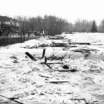 Image of UNRS-P1992-01-1943 - Negative only. Photograph of Truckee River Flood; downtown Reno; ca. 1920s