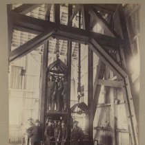 Image of UNRS-P1992-01-4083 - Photograph of miners in cage. Park City, Utah. James C. Crockwell photo?