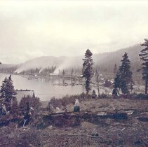 Image of UNRS-P1992-01-5927 - Photograph of view of Glenbrook Bay, Lake Tahoe, showing saw mills, breakwater and steamers of Carson and Tahoe Lumber and Flume Co., also terminus of Lake Tahoe, N. G. R. R. [Watkins photo number 1020].  Photo by Carleton Watkins.