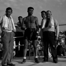 Image of UNRS-P1992-01-3470 - Photograph of Tony Polini and John Henry Lewis [fight]
