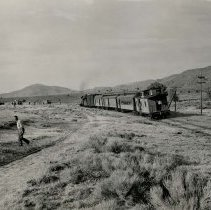 Image of UNRS-P1992-01-4505 - Photograph of 14. The Virginia and Truckee Railroad last run program in 1950 at Steamboat Springs is over and the last official train over the famous line heads out for Reno, Nevada. The proceedings were funereal in many respects and many tears were seen as most of the people present were familiar with the past glory of the famous railroad.