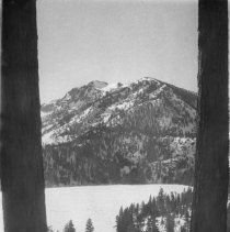 Image of UNRS-P2003-10-168 - [Emerald Bay framed by two large tree trunks]