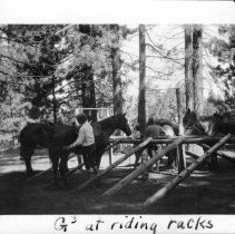 Image of UNRS-P1993-05-0445 - Photograph of G3 at riding racks. 1930. [In album: Camp Chonokis, 1927-31]