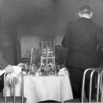 Image of UNRS-P1997-58-171 - In the Woodside residence diningroom, Fire demonstration gone awry in the 1930's