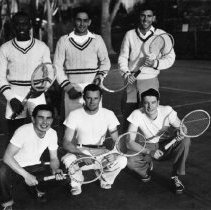 Image of UNRA-P1254-1 - The 1949 Nevada men's tennis team poses together for a photograph while holding tennis rackets. Tennis team: Fred Smith; Ron Brubaker; Paul Reimer; Alva Tabor; Alex Henderson; Drake Delonoy (March 1949)