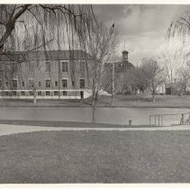Image of UNRA-P230-02 - This exterior shot taken from Manzanita Lake shows the Alice McManus Clark Library (photographic print, 4.75 x 6.75 inches). The Alice McManus Clark Library, later known as the Clark Administration Building, originally opened in 1927 as an upgrade to the existing library housed in the current day Jones Visitor Center. Today the building houses the President's Office, Provost's Office, and other administrative faculty offices. (1931)