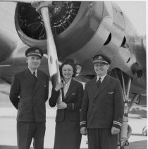 Image of UNRS-P1997-58-034 - Flight crew of the Thunderbird with Toots Burger in the center