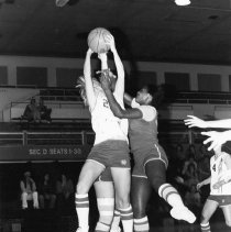 Image of UNRA-P901-1 - Photograph of women's basketball game against Stanislaus State: unidentified players. Handwritten on verso: UNR vs Stanislaus State.