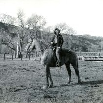Image of UNRS-P1985-08-00067 - Photograph of Girl on horse (neg. 4x5) Folder 193.