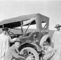 Image of UNRS-P2000-06-1038 - John Dixon on the way to Frisco in an old Dodge, near the Little Truckee. [Women are three of these four: Sadie D. Hurst, Nell Hymers, Bessie Eichelburg, Crissie Caughlin]