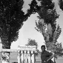 Image of UNRS-P2006-04-232 - [Clark Gable with Pyramid Lake trout; Pyramid Lake Club; 1934]