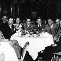 Image of UNRS-P2007-04-48 - Picture taken at Mapes. Left to right: 1. Frank Grannis; 2. Lou Wertheimer, late co-operator partner Mapes 1947, later: Riverside Hotel--co-partner; 3. Bernie Einstoss, Mapes 1947-1954, co-partner Bal Tabarin, Tahoe, co-partner Horseshoe Club, Reno, co-partner Riverside Hotel, Reno; 4. Thelma Einstoss; 5. Mert Wertheimer, Riverside Hotel co-partner; 6. Ruby Mathis, Mapes Hotel, later: Riverside Hotel co-partner of Lou and Mert Wertheimer; 7. a friend; 8. Joe Hall--co-partner Primadonna Club, Reno; 9. a friend