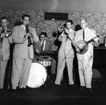 Image of UNRS-P2007-04-55 - Jack Buck, [?], [Fred Higuera?], Bob Scobey, Clancy Hayes, Burt Bales. [Bob Scobey's Frisco Band] July 25, 1953. Photo by David Polos.