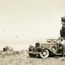 Image of UNRS-P2006-04-126 - [Man with automobile; Pyramid Lake in background; ca. 1932]
