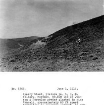 Image of UNRS-P2008-18-3651 - Quarry blast, Picture No. 1, R. E. Dillery, Foreman, 28,500 lbs of Judson & Hercules powder planted in nine tunnels, approximately 50 ft apart. Detonation by electric current. 30,000 cu. yds. rock moved. Camera at hill east of quarry. June 1, 1913.